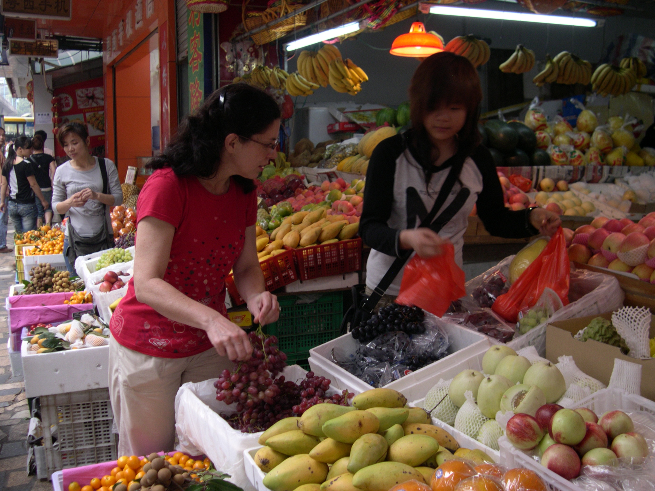 my sister shopping at the fruit market