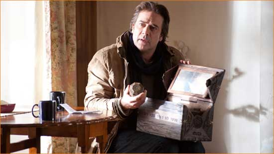 "Clyde (Jeffery Dean Morgan) rummages through his daughter's box in ""The Possession""."