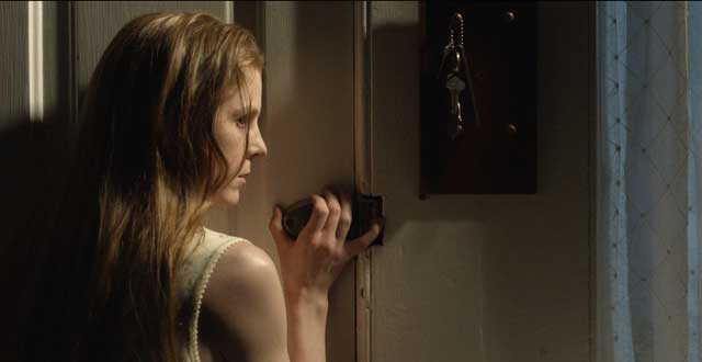 """Nell (Ashley Bell) tries to keep the evil at bay in """"The Last Exorcism: Part 2""""."""