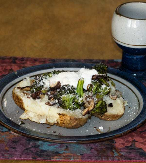Baked potato with broccoli, shallots, and shiitake mushrooms
