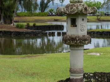 Liluokalani Gardens statuary with lagoon in background