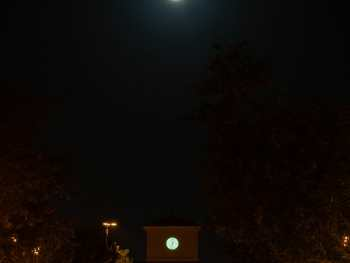 Moon lined up over clock tower