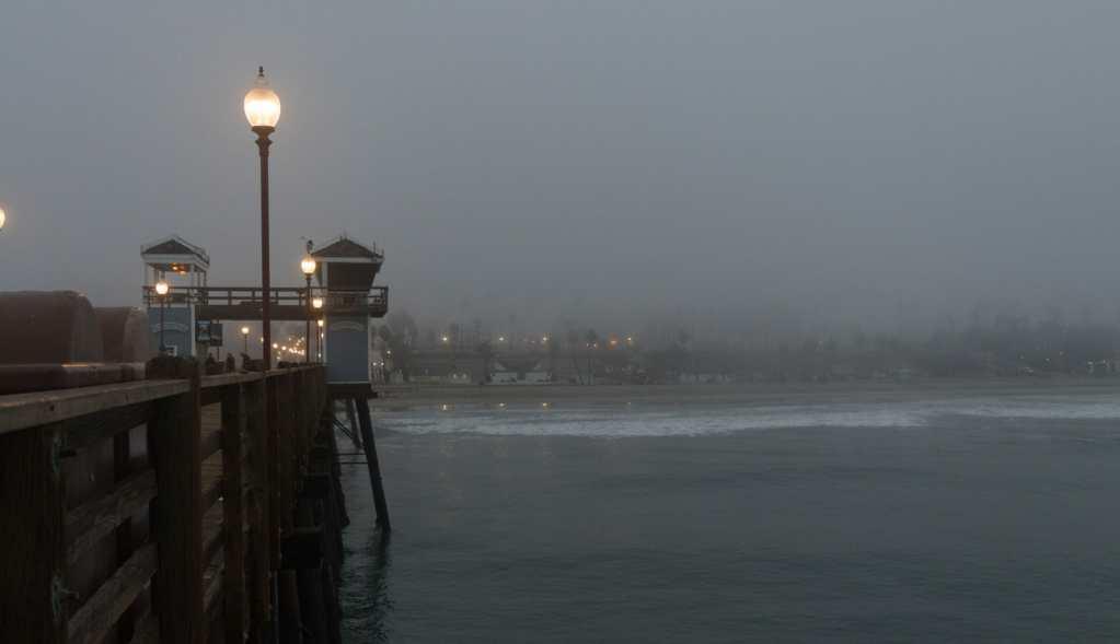 Oceanside Pier looking back toward shore on a foggy morning
