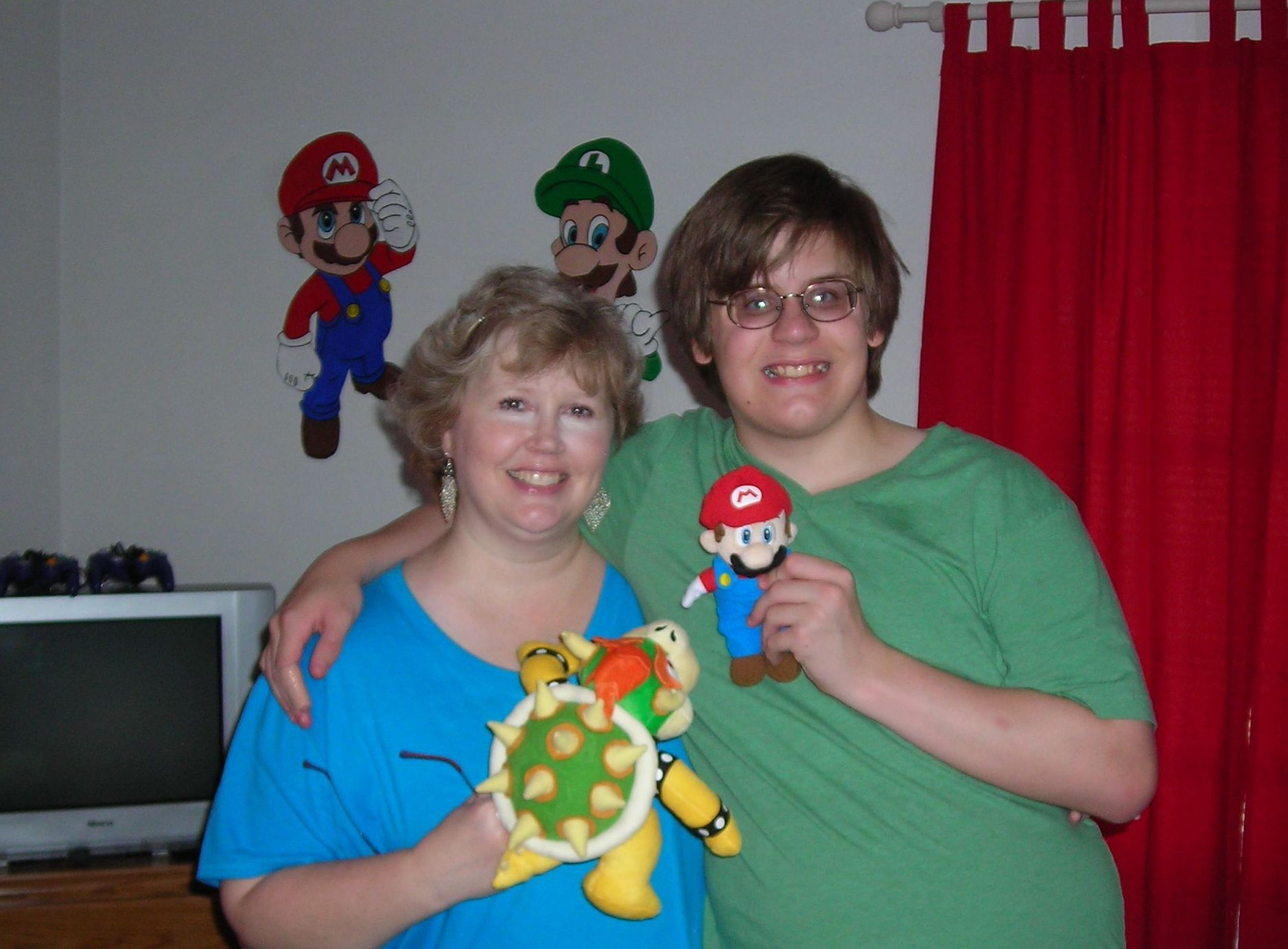 playing around with bowser and mario. can\'t believe how tall my boy is!