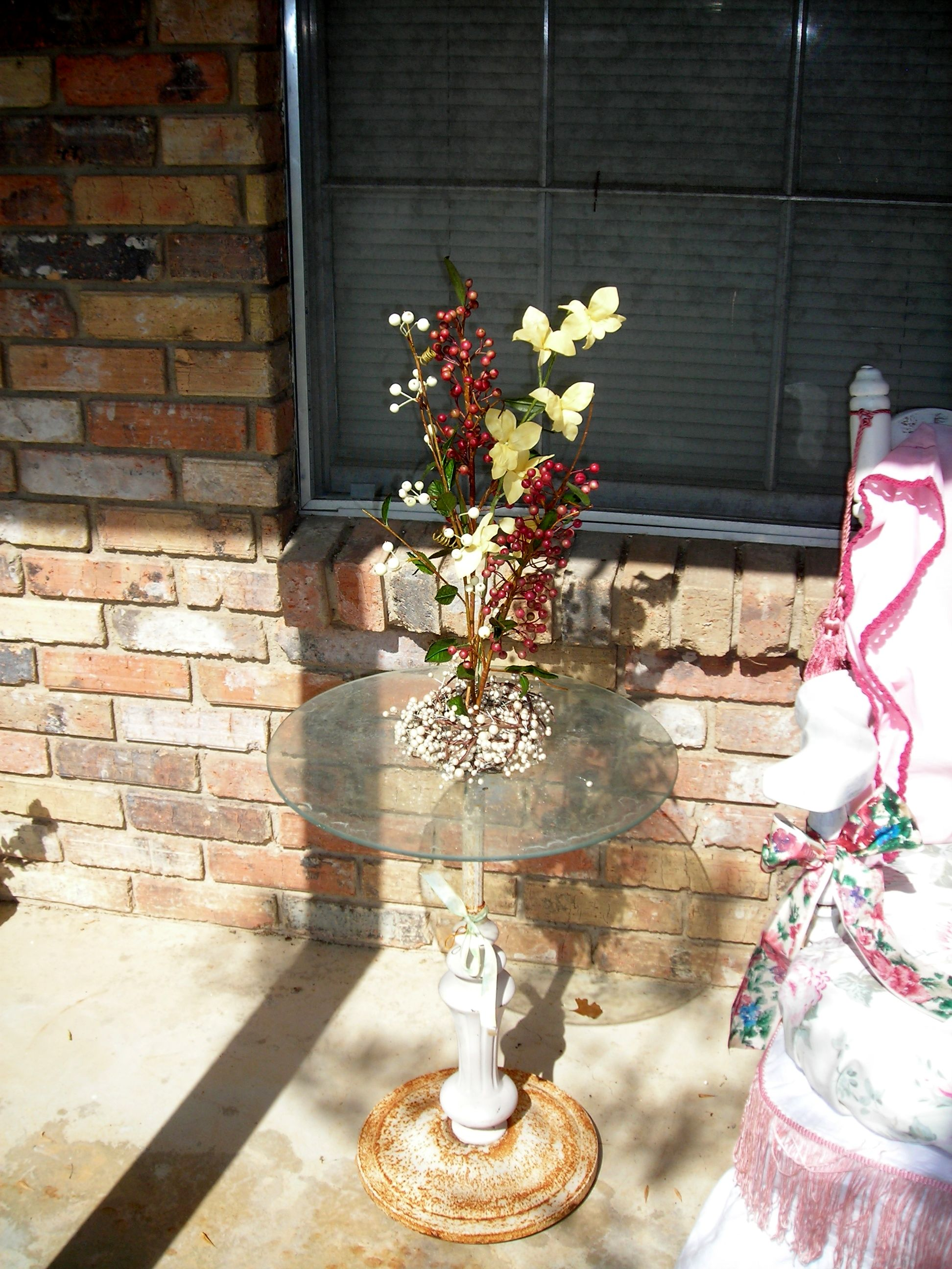 precious little table with glass top ... i stuffed some flowers into the center hole for an instant flower arrangement!