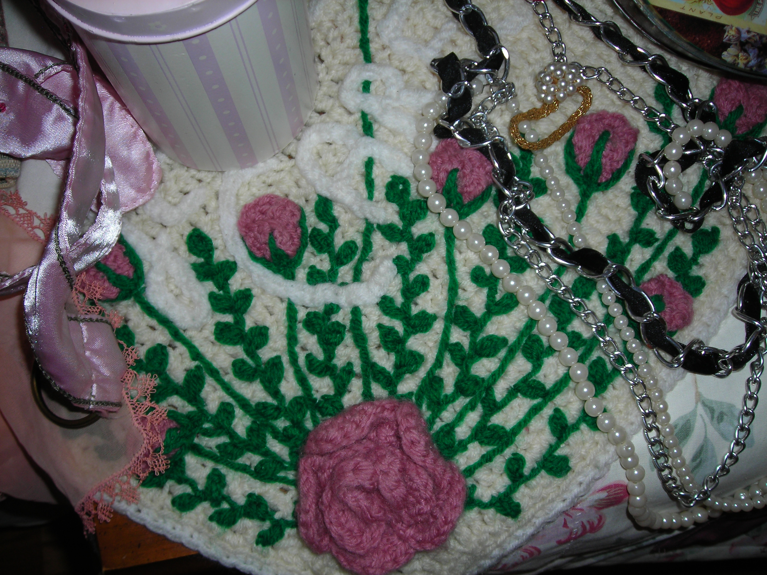 Crocheted pretty. It says 'Jesus Cares', but I like the pink roses on it. I mean, I KNOW Jesus cares ... yikes.