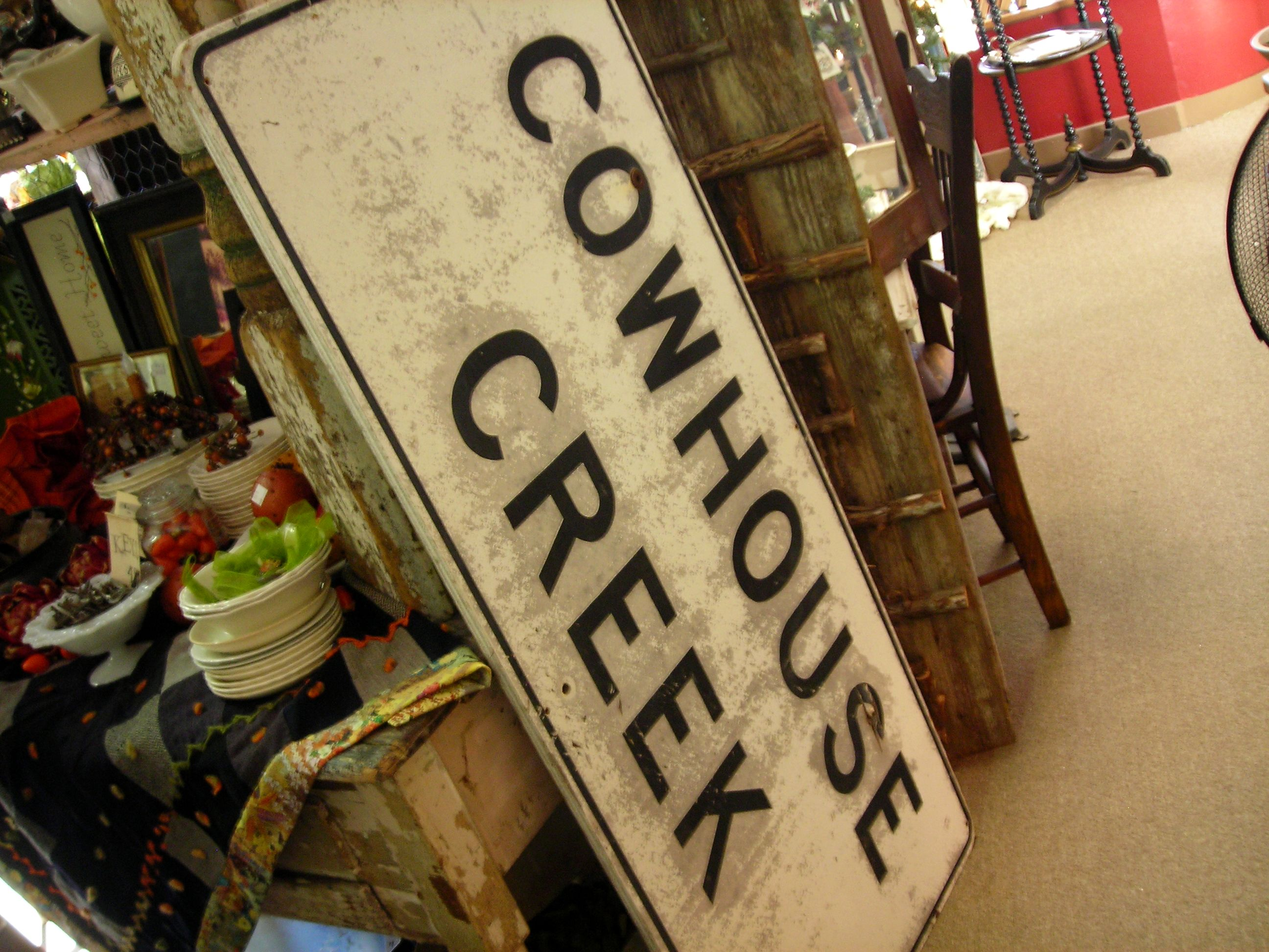 i ADORE this old sign. my daddy taught me to fish off the banks of cowhouse creek. love it!!