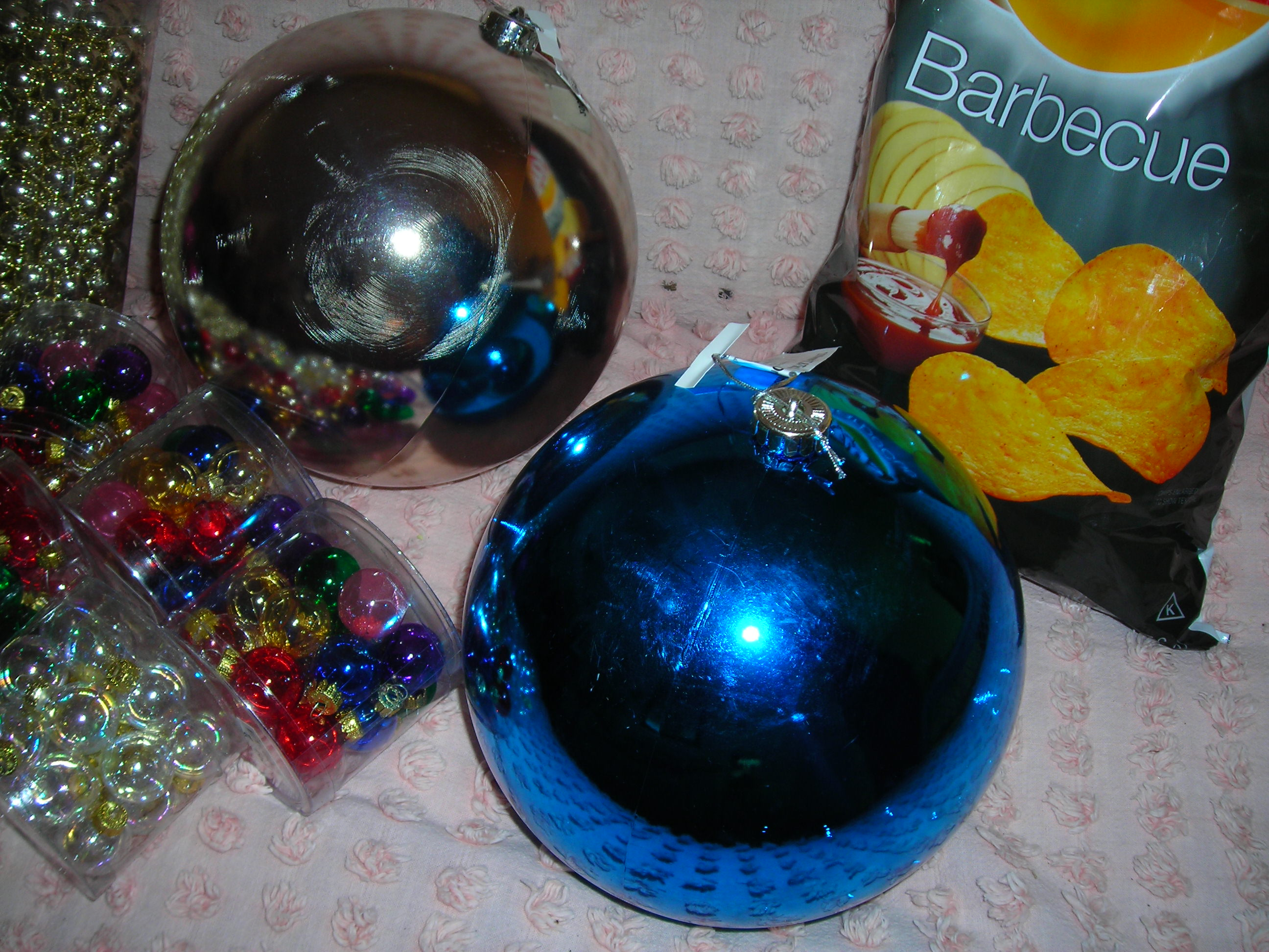in case you can't telll, these are HUGE-GIGANTIC ornament balls. about the size of bowling balls, 40 cents each. may pull a vintage sue and paint them and the fire up the glue gun ...