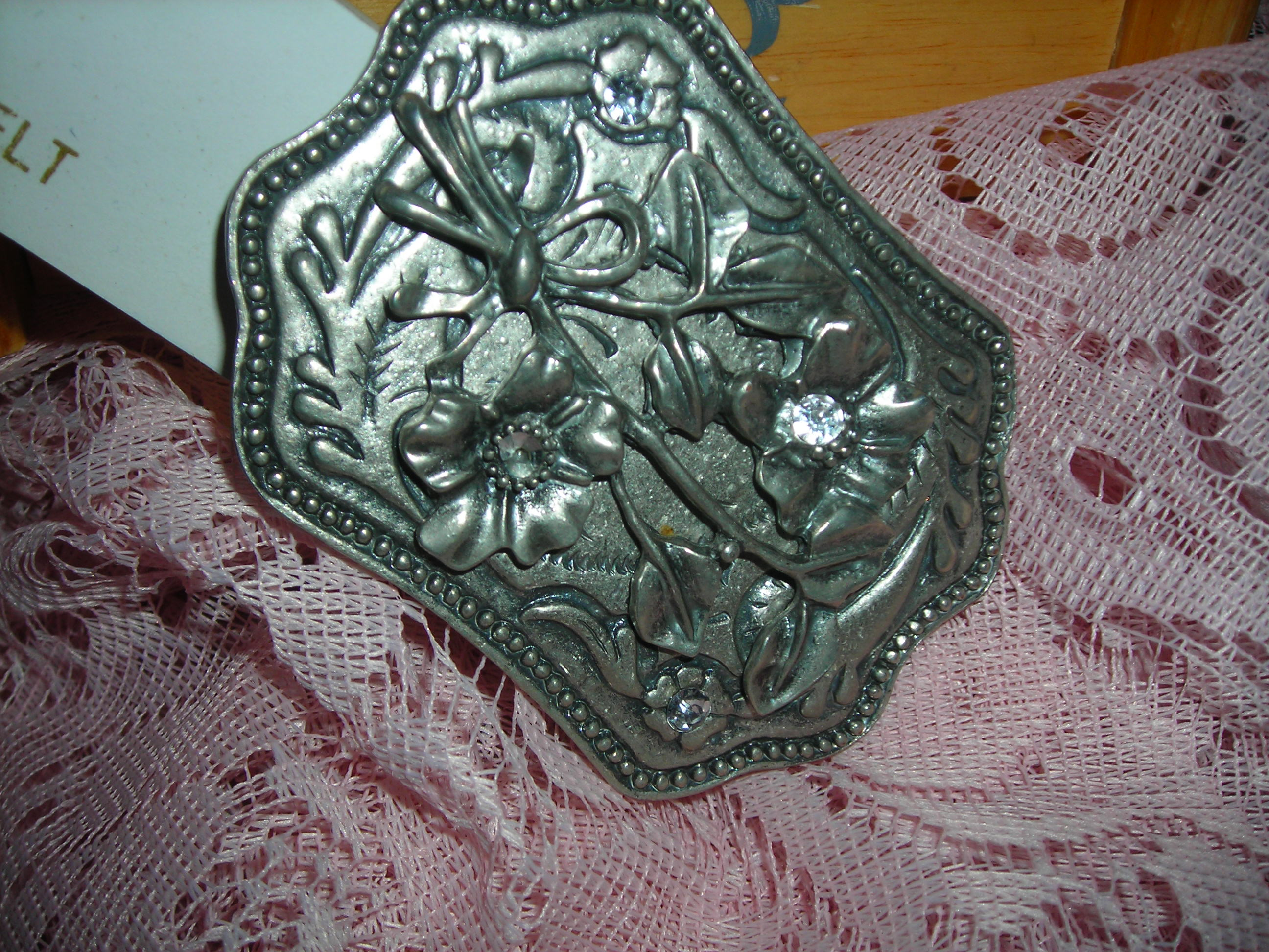belt buckle bought because of bling ... but you can't see it very well in this pic