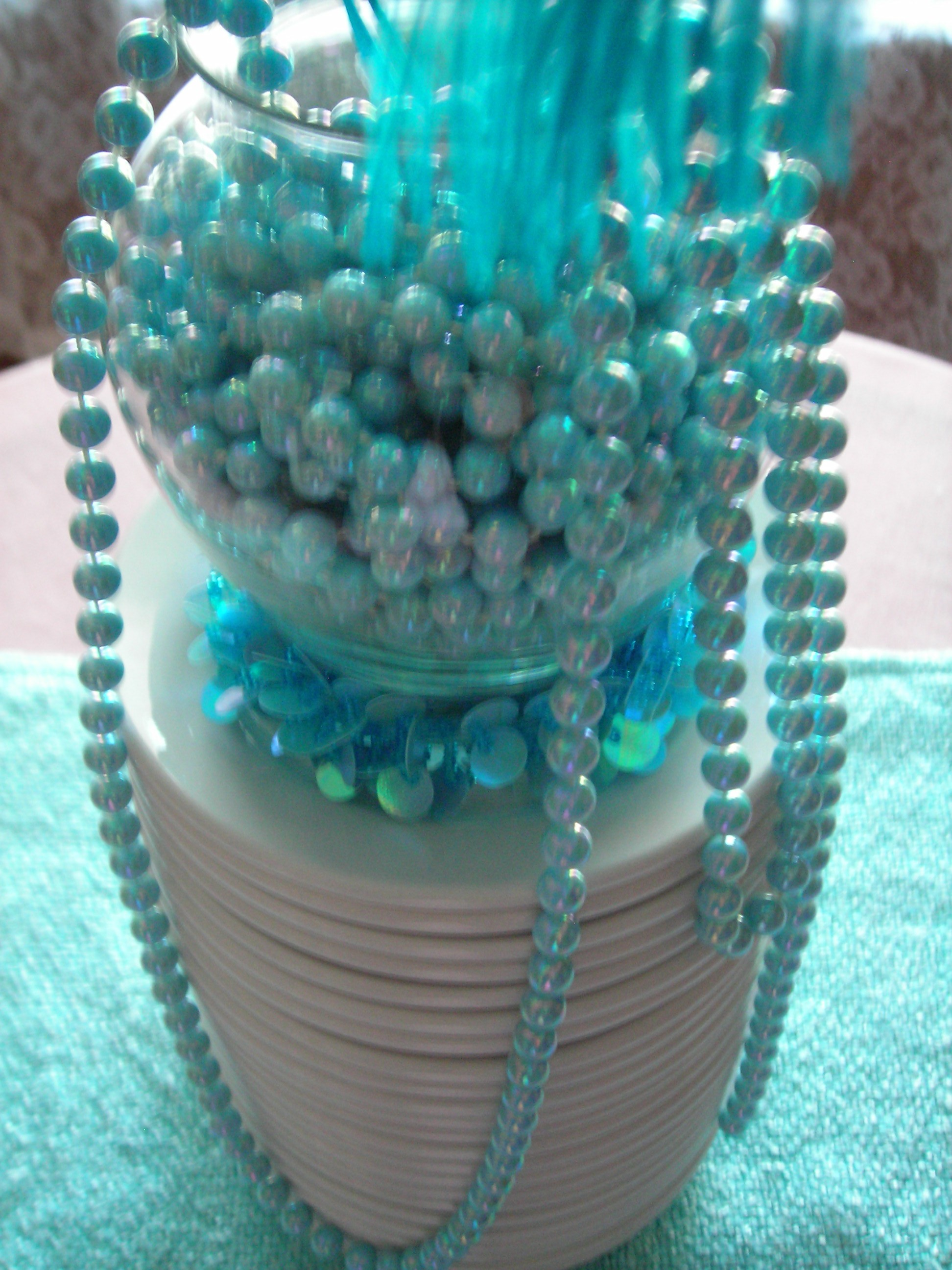 stacked my freebie plates and used them as a pedestal for a beads and feathers table centerpiece