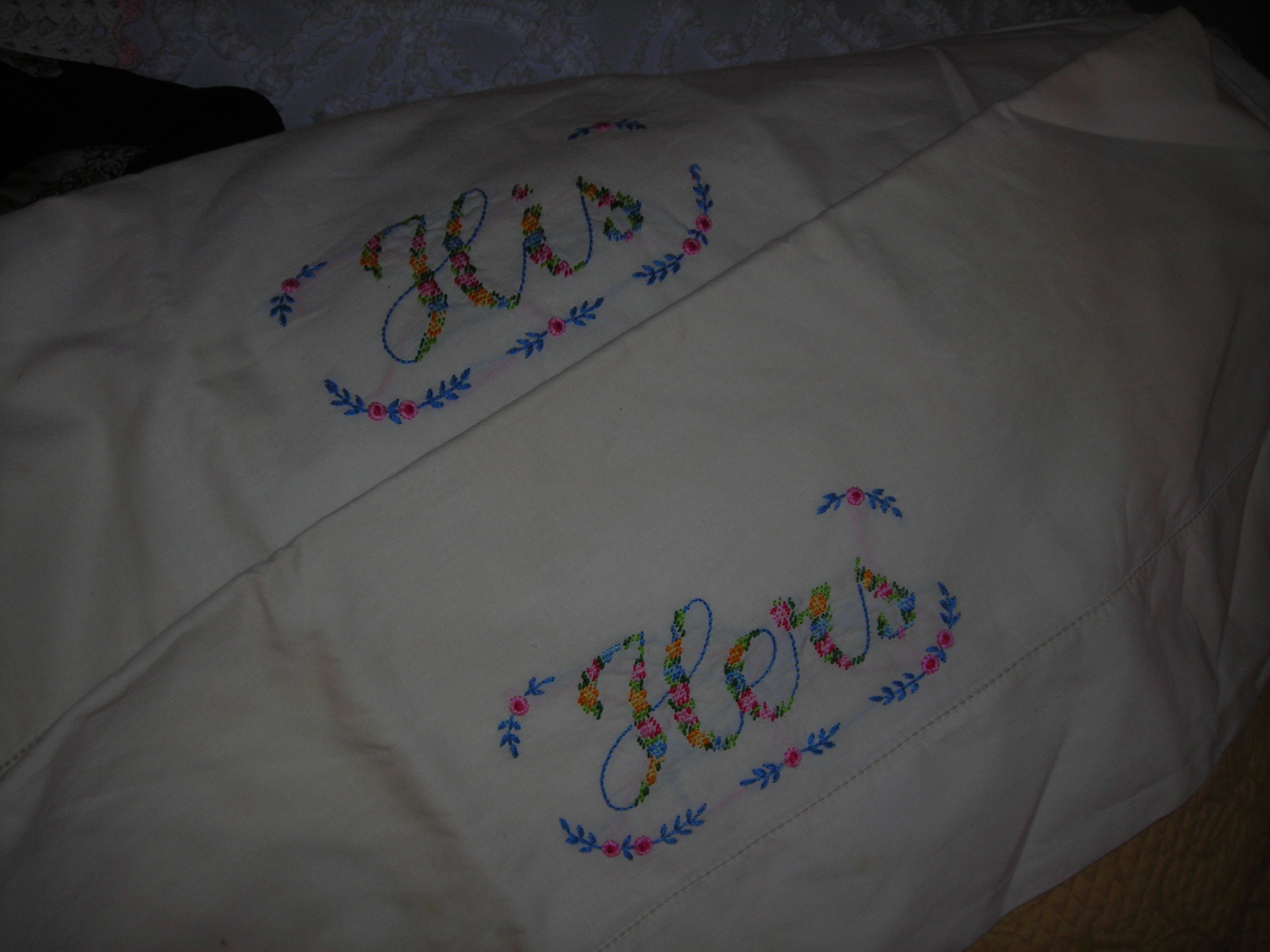 his and hers vintage hand-embroidered pillowcases ... hubby's gonna LOVE his! heehee