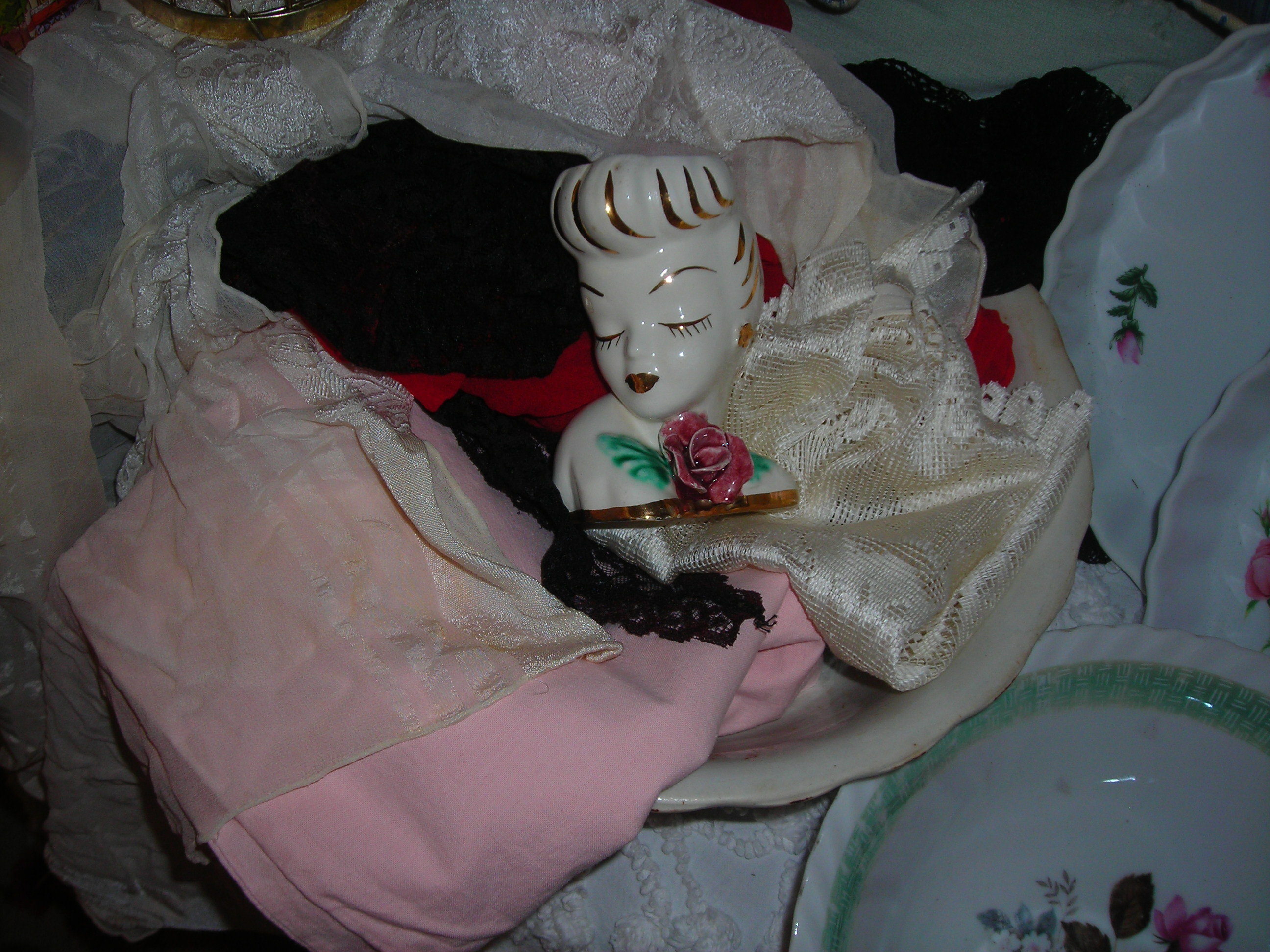 old bowl filled with vintage linens, scarves and my beautiful lady figurine