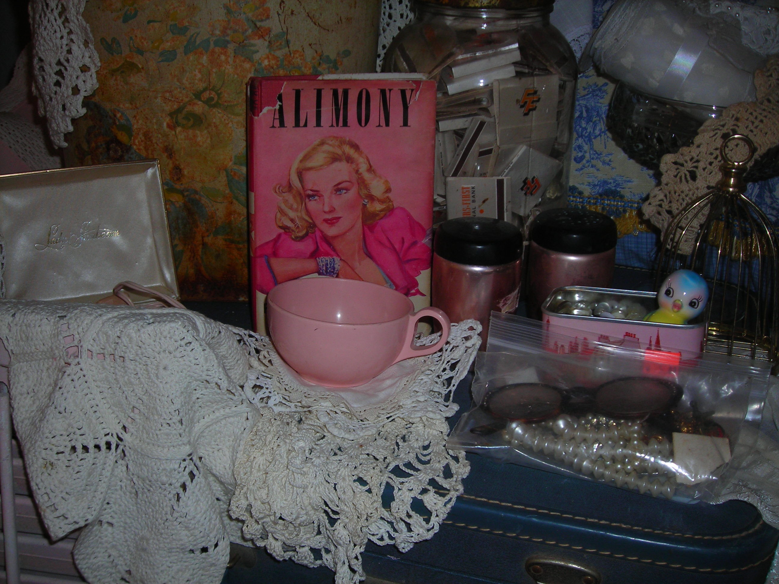 a few of my lovelies ... love that 'alimony' book from the 40s! and ohmygosh, that pink melamine cup!!