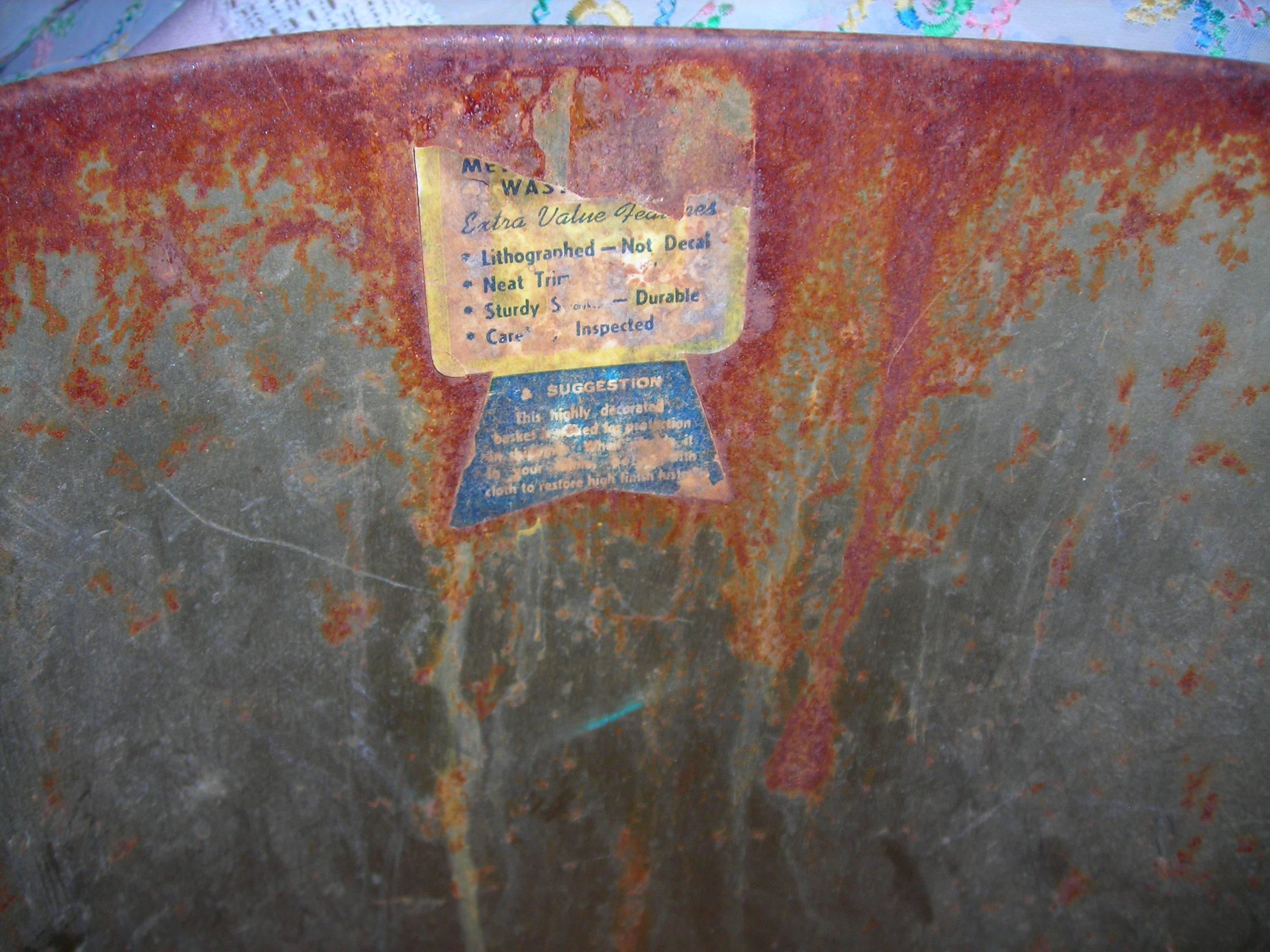 inside of trash can, sticker describing how wonderful it is!
