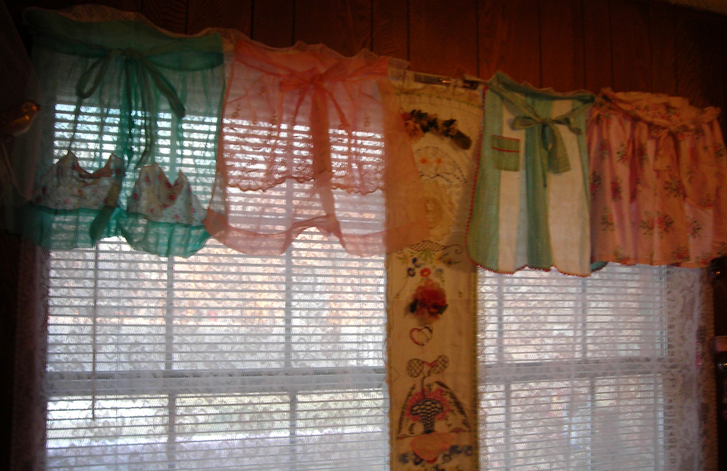 love this look! vintage aprons as valances on my kitchen window