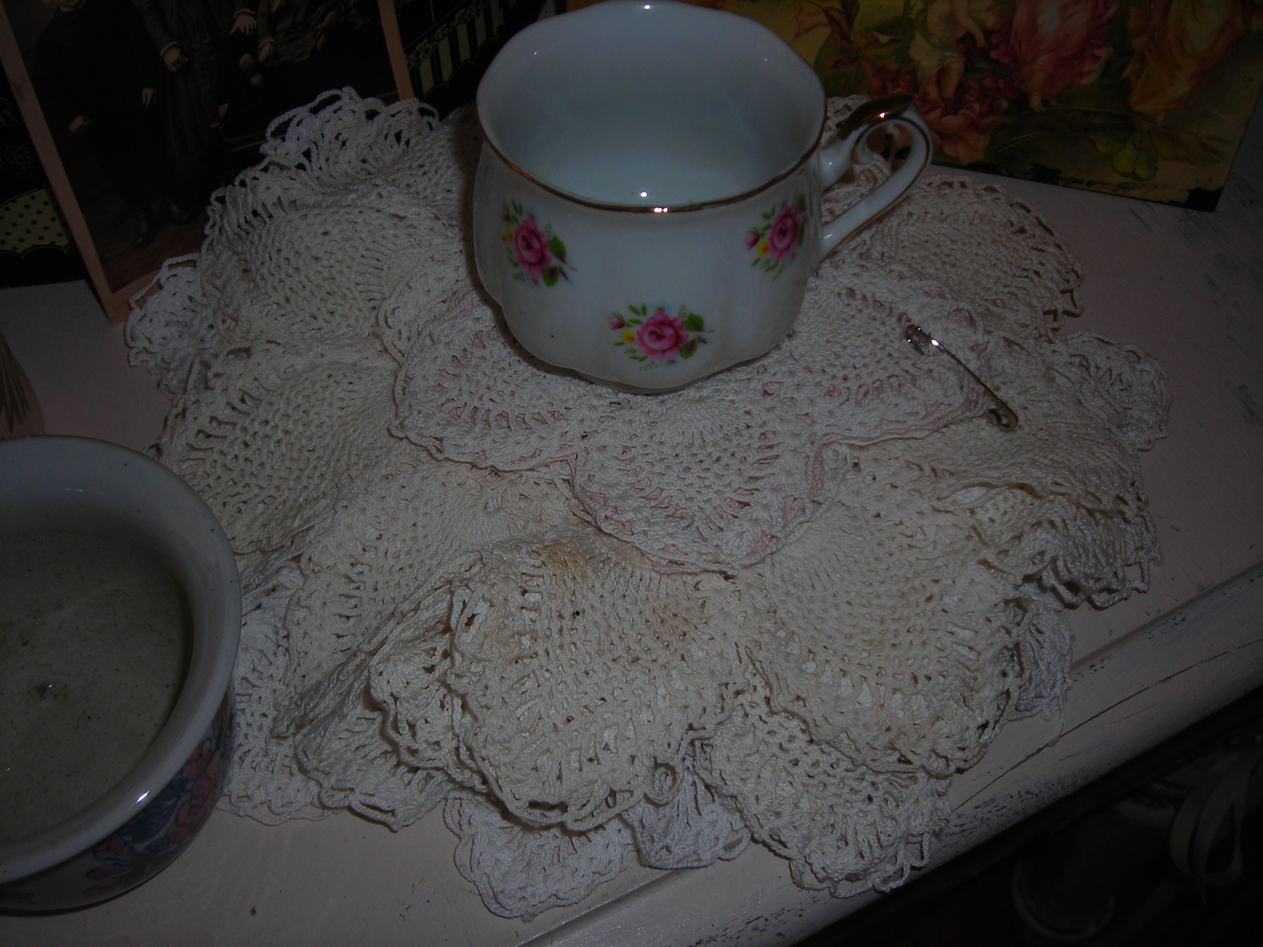 a PILE of vintage crocheted doilies for 25c. wow.