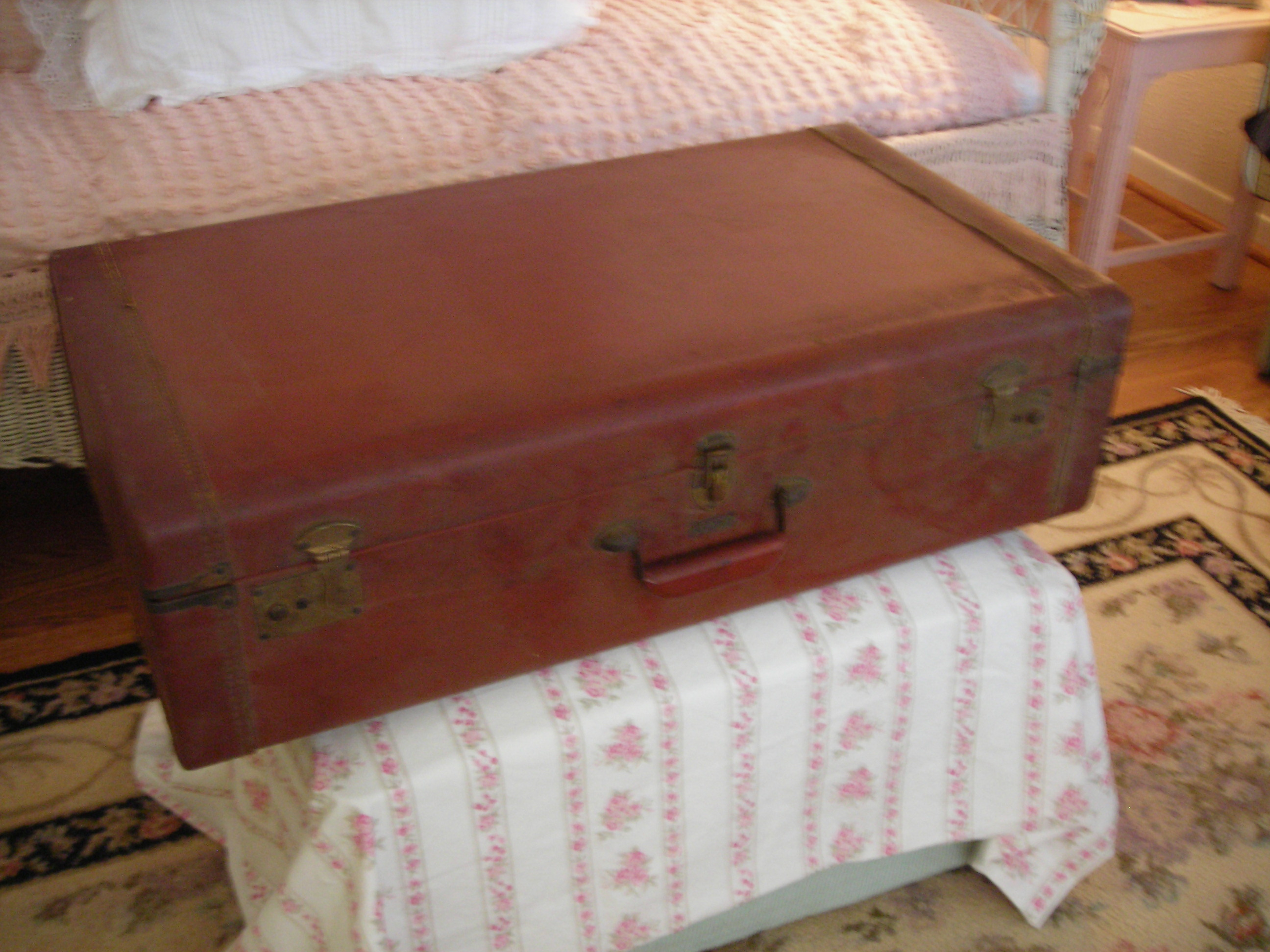 vintage luggage piece for $1.50. are we seeing pink yet?!