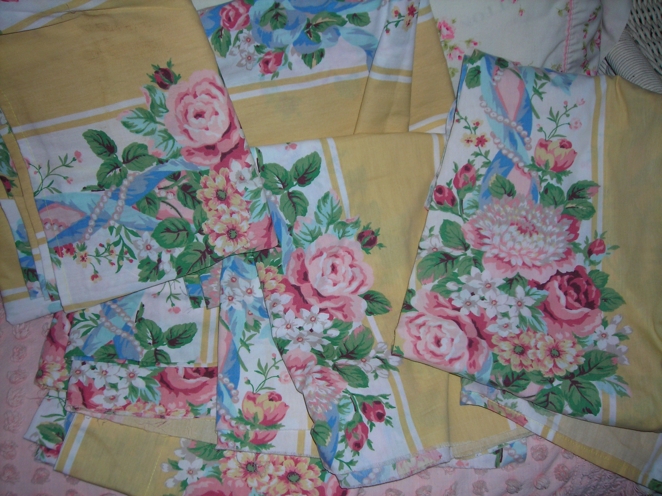 sweet, sweet yellow and rose fabric ... TONS of it from the GW bins