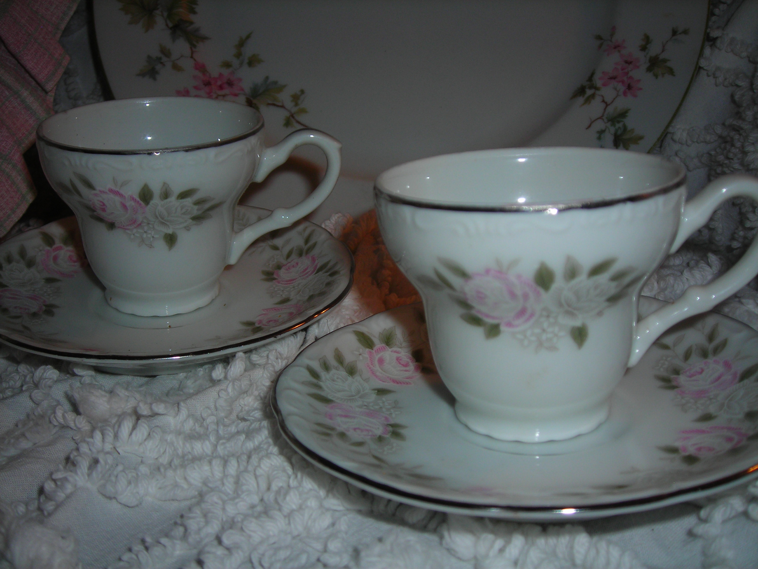 also from that sale, two little cups and saucers. v. dainty and feminine