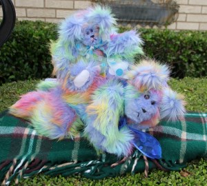 Blue rainbow bear on tummy with baby (640x577)