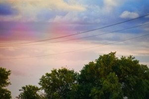 Rainbow taken with camera but by that time it was fading. Used color enhancement and it appears there were two rainbows.