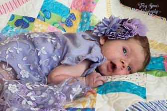 baby in purple 900 087