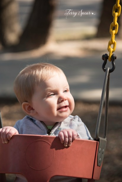 baby swinging and smiling 1000 120