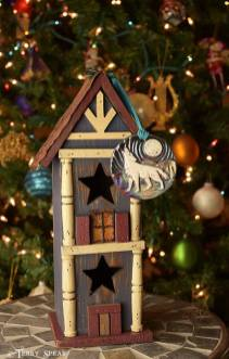 wolf ornament howling on birdhouse