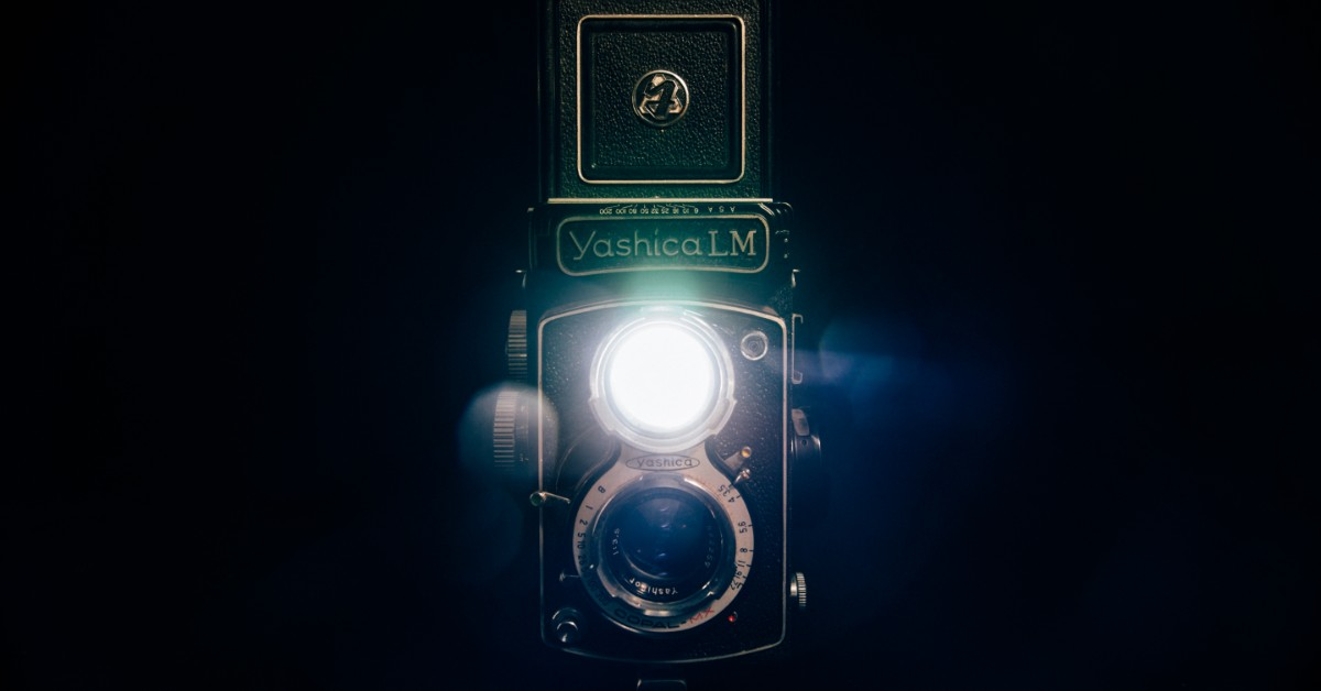 Antique camera with a bright flash
