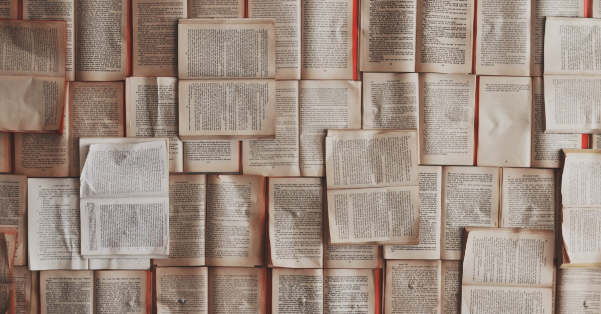 An overhead shot of open books and their pages