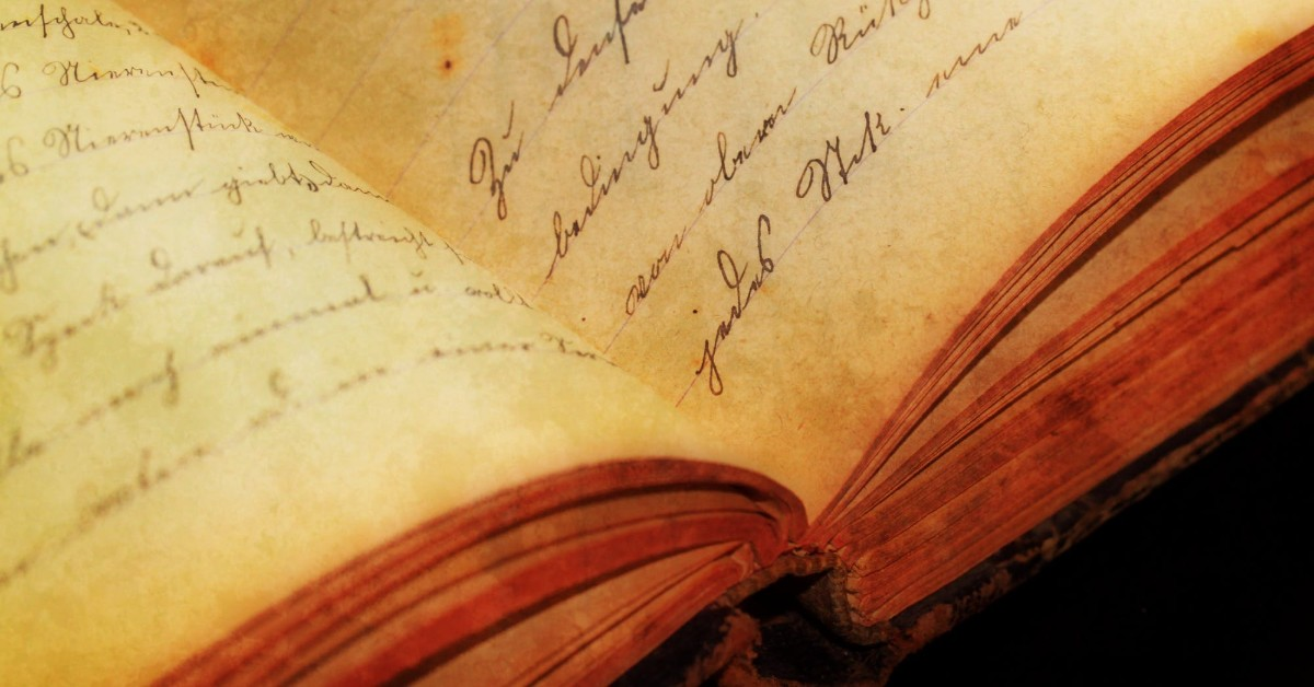 The yellowed open pages of an old book