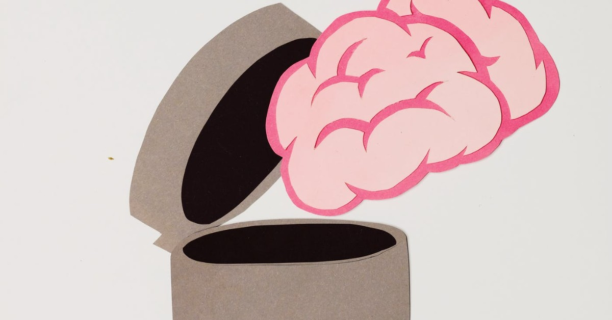 Cartoon of a brain falling into a garbage can