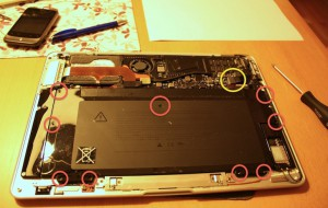 MacBook Air inside view, battery screws marked