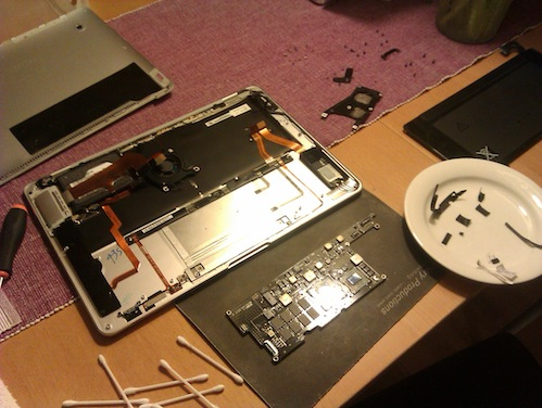 Logic board removed from MacBook Air casing
