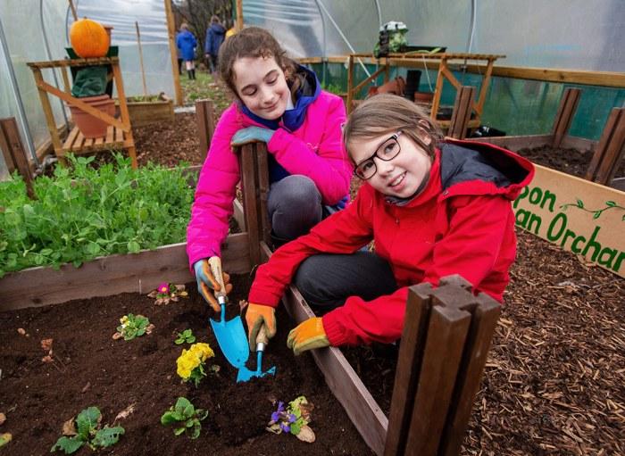 Children planting at a community garden