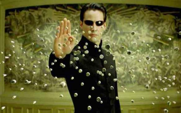 matrix movie review picture of neo stopping bullets