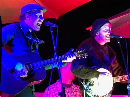 Mick and John harmonise.