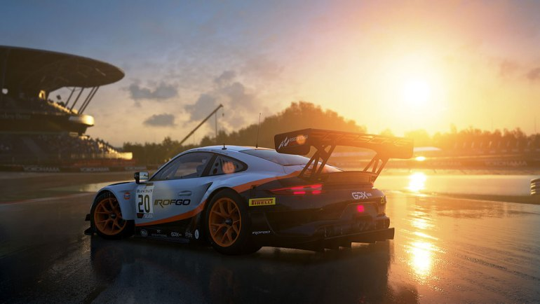 Screen di gioco al tramonto sul bagnato Assetto Corsa Competizione