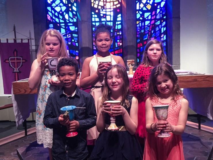 Children holding chalices