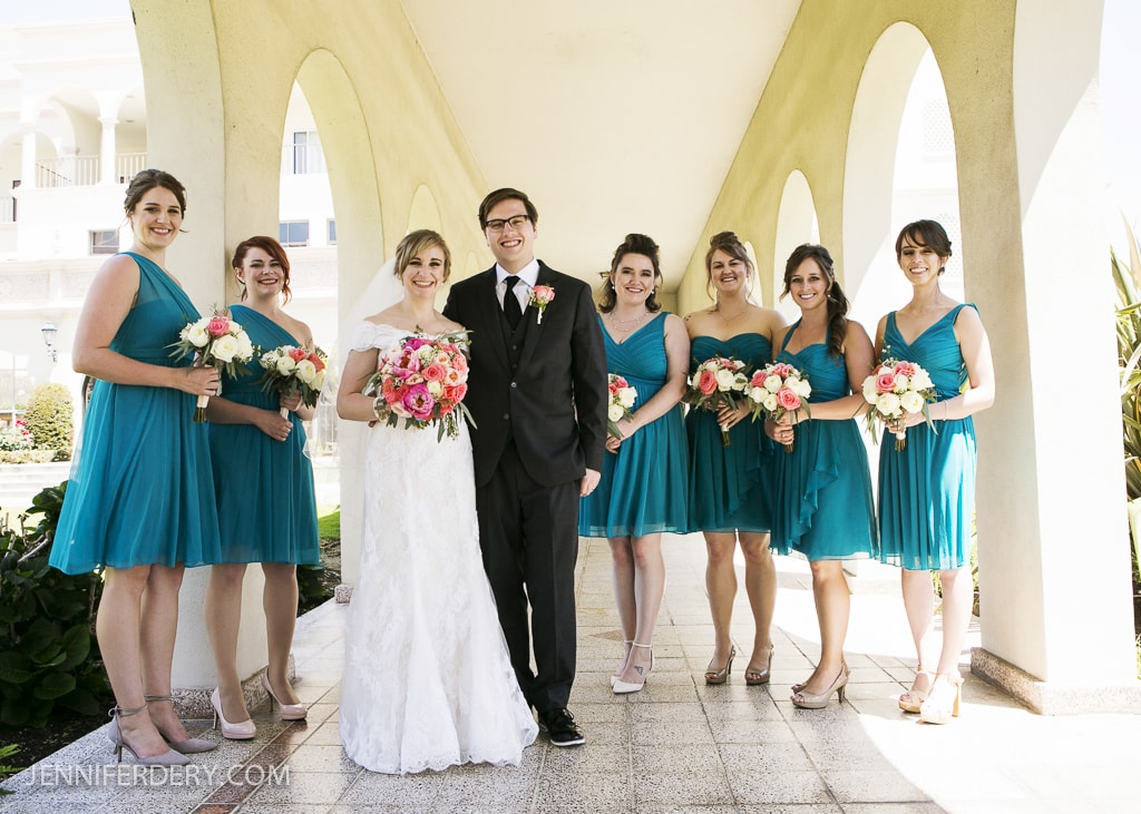 Photo of bridesmaids in teal / turquise short dresses. Customized designs