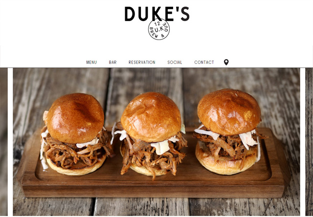 Image of a restaurant website: Duke's Brew & Que