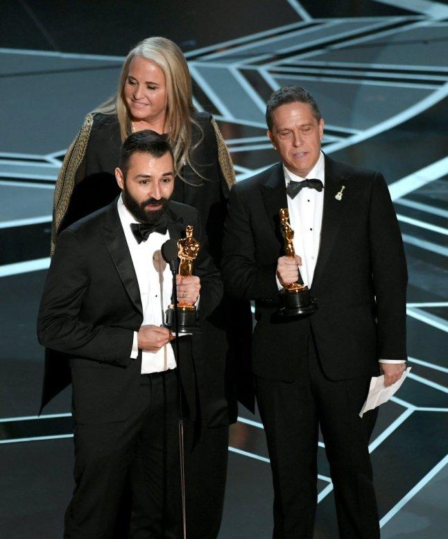 Adrian Molina, Darla K. Anderson und Lee Unkrich erhalten den Oscar für den Besten Animationsfilm