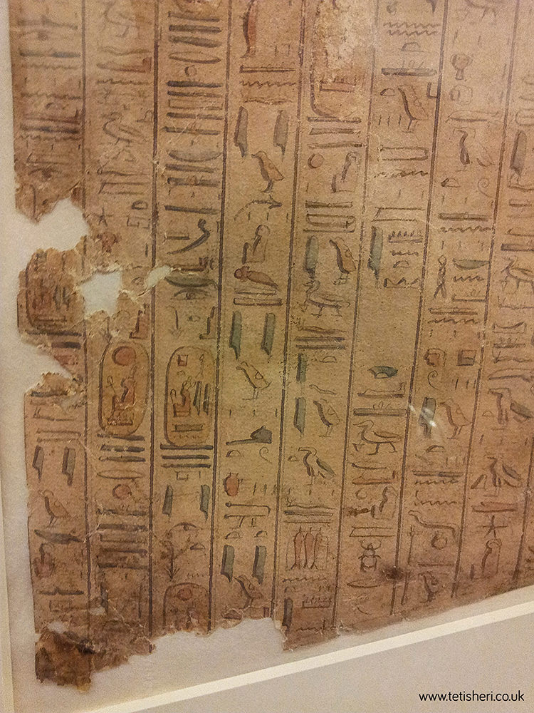 The hieroglyphs are painted in vertical columns and have some colour in them