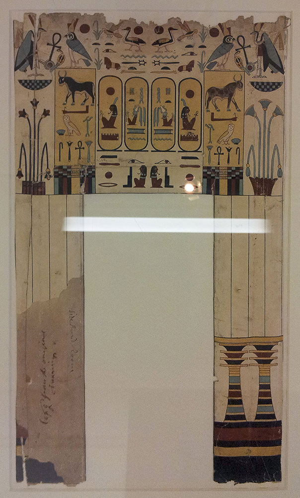 Decorations and hieroglyphs along the top of a door lintel and down the columns at the side of the doorway