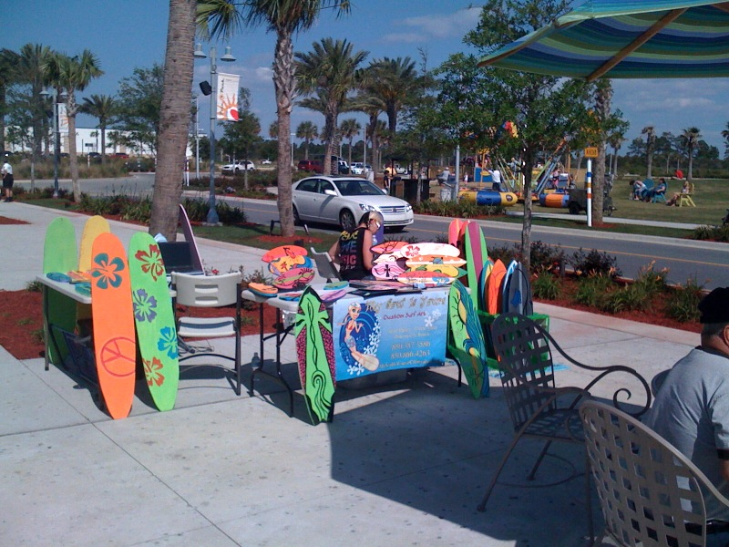 Becoming a business owner after bankruptcy: painting and selling surfboards on the beach.