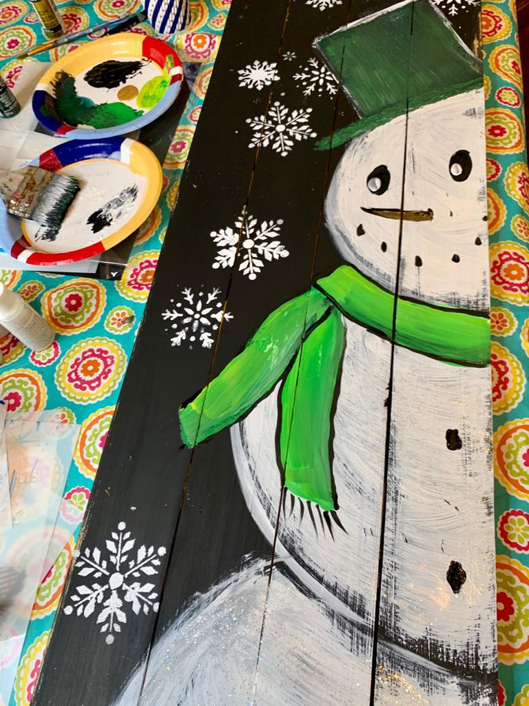 Painted snowman porch leaner with green scarf and hat