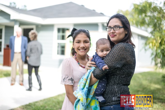 New homeowner Elizabeth Gonzalez and family.