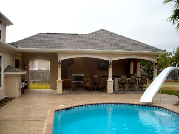 pool house with outdoor kitchen Pool House With Outdoor Kitchen & Fireplace In Cypress - Texas Custom Patios