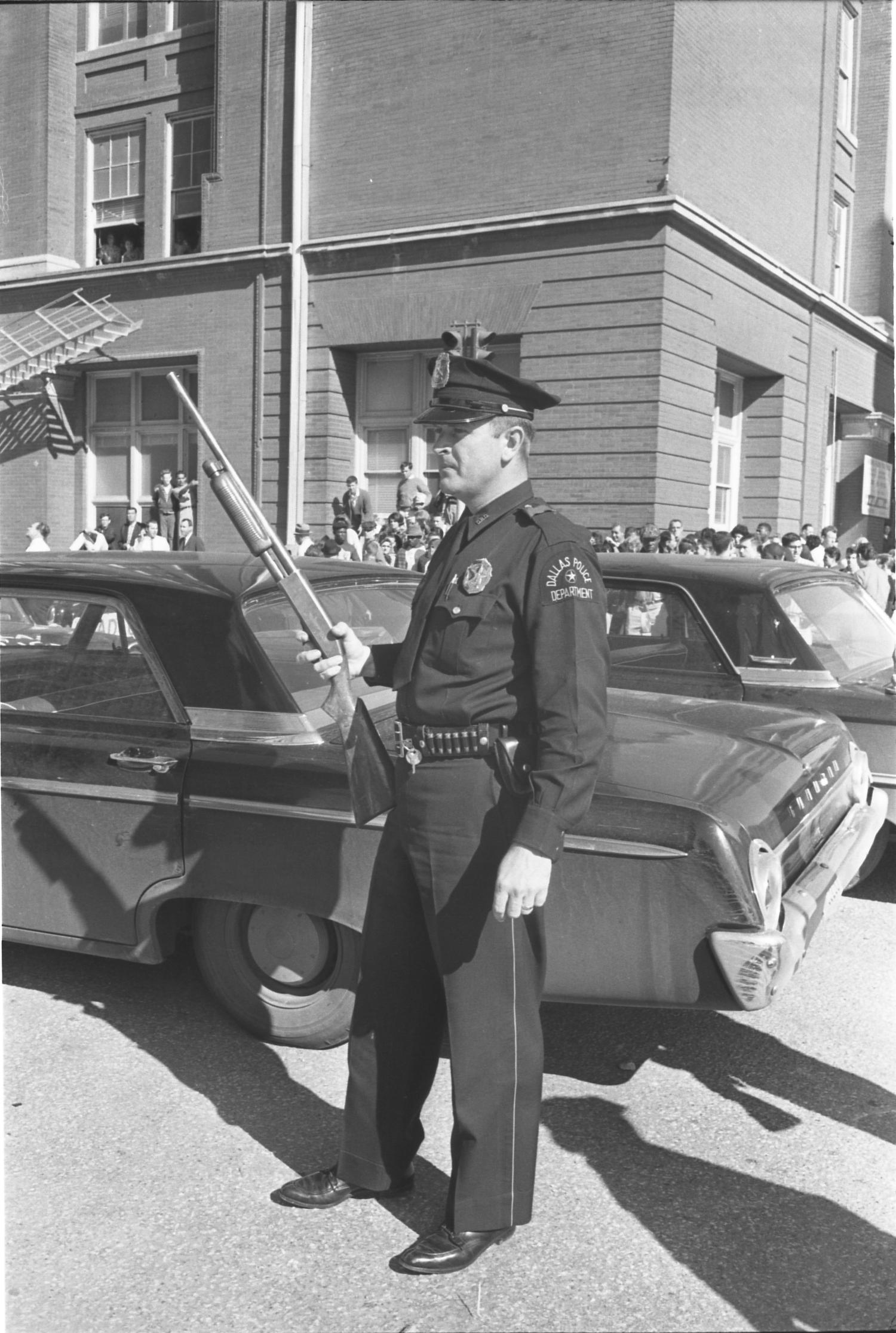 A Dallas Police officer outside the Texas School Book