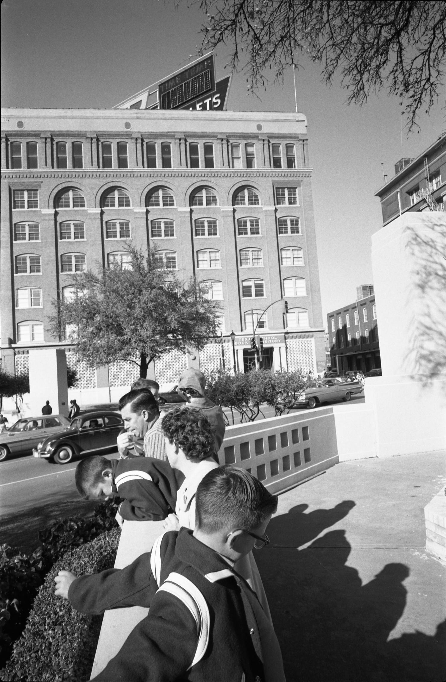 People in Dealey Plaza the day after the assassination